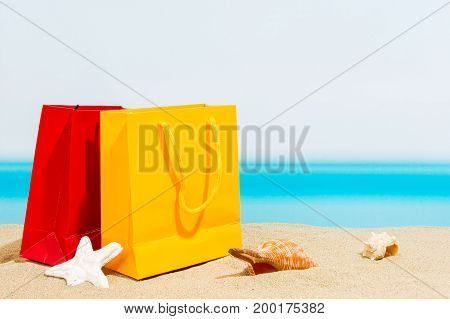 signings bags on the beach, sea in summer