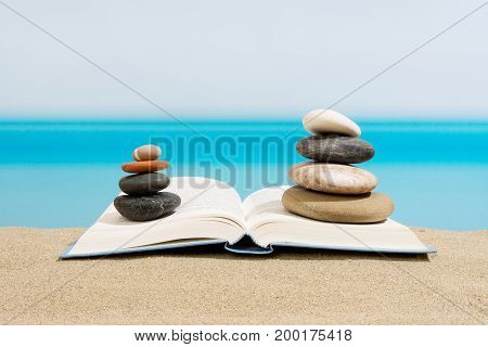 Book on the beach in relax, sea in summer