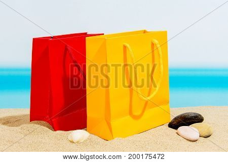Summer signings bags on the beach, sea in summer
