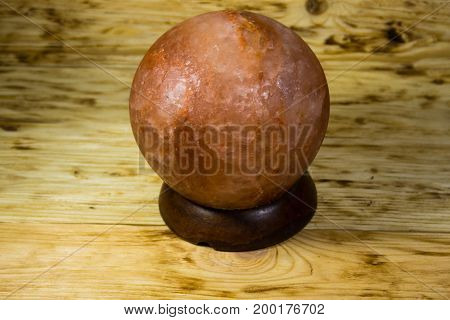 Himalayan salt lamp on the wooden background