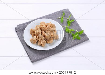 plate of soy meat cubes on grey place mat
