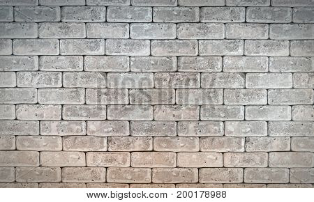 Abstract weathered old vintage dirty brick wall texture gray grunge background with with vignetted corners may use for interior design. Brickwork background in rural room architecture wallpaper.