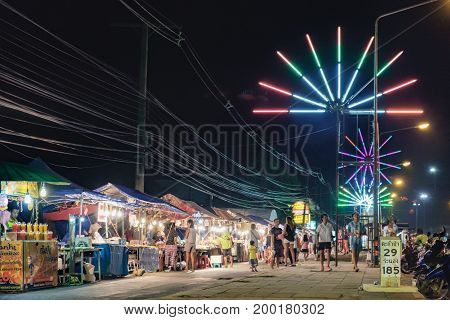 Khao Lak, Thailand - January 27, 2016: Mobile night market along the main road in Khao Lak - Phet Kasem Road. Street cooking is a tradition and ubiquitous in Thailand.