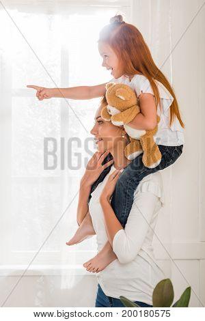 Mother And Daughter Piggybacking