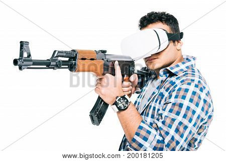 Man In Virtual Reality Headset With Rifle
