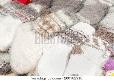 Handmade warm knitted socks in the market