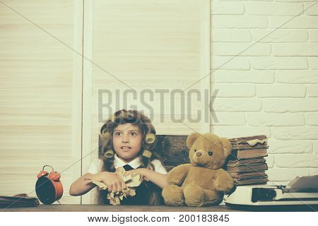 Education and childhood. Little baby secretary with bear and book. Kid choose career. Small girl with curler in hair. Child with alarm clock.