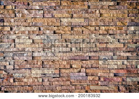 Detail of natural stone wall cladding .