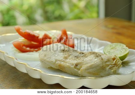 boiled chicken dressing soy sauce with salad low fat protein for  build muscle food on plate