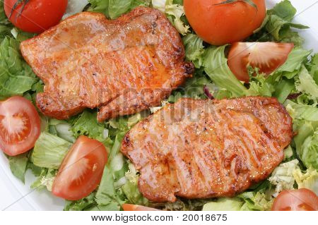 Grilled Sirloin Steak On A Salad With Tomatoes