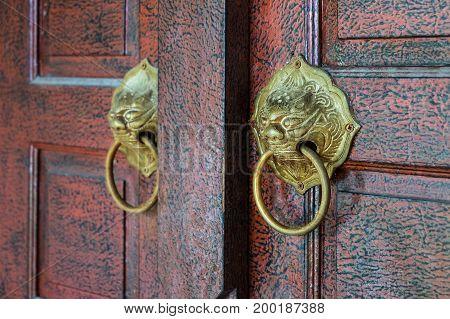 ancient vintage gold knock on wooden door