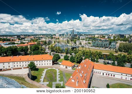 Vilnius, Lithuania  - July 5, 2016: Modern City And Part Of Old Town. Behind New Arsenal At Northern Foot Of Castle Hill, One Can Spot Foundation Of Church Of St. Ann And St. Barbara