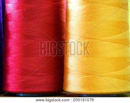 Close-up sewing threads multicolored background. A beautiful combination of colors.
