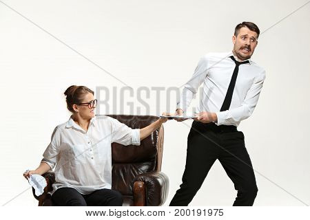 The young man and beautiful woman in business suits at office isolated on white background