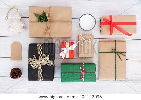 Christmas background - Christmas handmade present gift boxes and rustic decoration on white wooden board. Creative Flat layout and top view composition