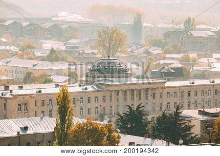 Gori, Shida Kartli Region, Georgia. Gori City Hall On Stalin Square In Autumn Misty Morning. Travel Destination poster