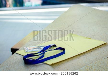 Name id card with cord on wooden background
