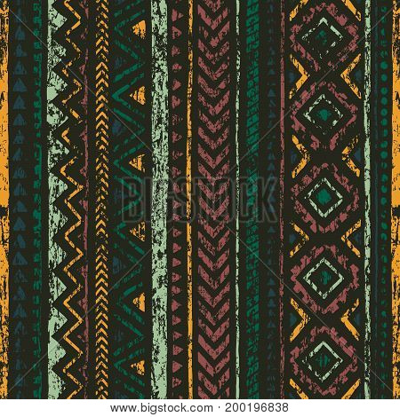 Old ethnic seamless pattern. Vertical geometric stripes. Aztec and tribal motifs. Grunge texture. Vector illustration.