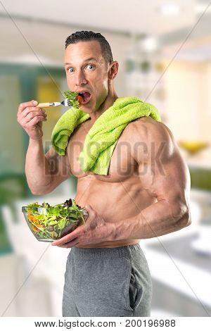 Healthy Man Eating A Salad