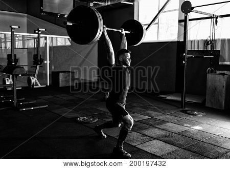 Fit Young  Athlete Lifting The Barbell In Gym. Gym Training. Full Body Length Portrait