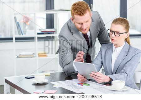 Businesspeople With Tablet On Conversation