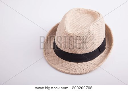 Clean light brown hat on white background