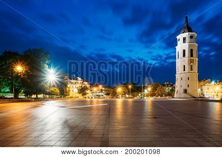 Vilnius, Lithuania. Night Or Evening View Of Bell Tower Near Cathedral At The Cathedral Square. Blue Cloudy Sky Background. Travel In Lithuania. Copyspace. Blue Hour