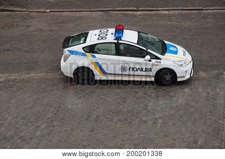 Hai, Ukraine - August 10, 2017: Toyota Prius - Ukrainian Police Car Riding On The Road.