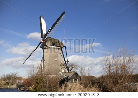 The old Dutch windmills, Holland, rural expanses . Windmills, the symbol of Holland. Holland windmill on a canal. The beautiful backdrop of the countryside of Holland Netherlands.