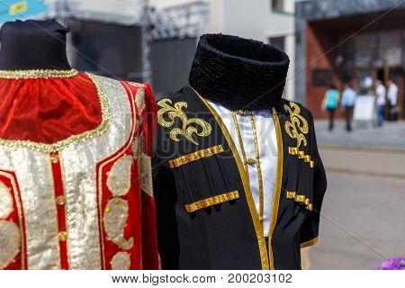Azerbaijani national costume hanging on a street hanger