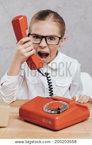Screaming Child With Telephone