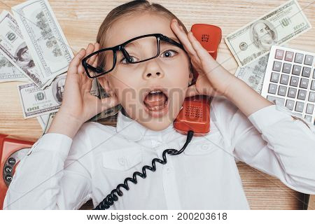 Kid With Telephone Tube At Workplace