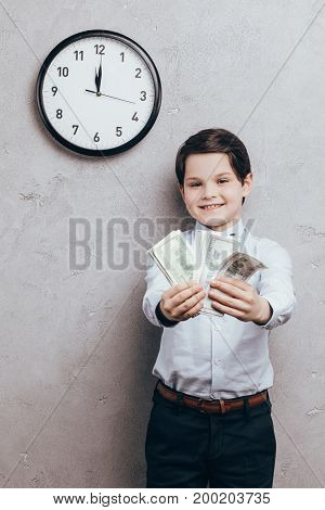 Smiling Child Showing Money