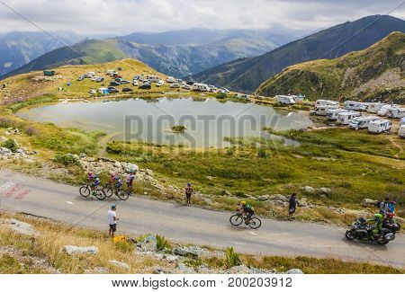 Col de la Croix de Fer France - 23 July 2015: Three cyclists riding to the Col de la Croix de Fer in Alps during the stage 20 of Le Tour de France 2015.