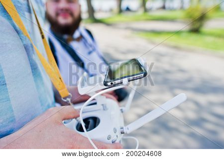Close-up Photo Of Male Hands Holding Remote Control Of A Drone.