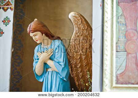 Close-up Photo Of An Angel Statue In The Church.