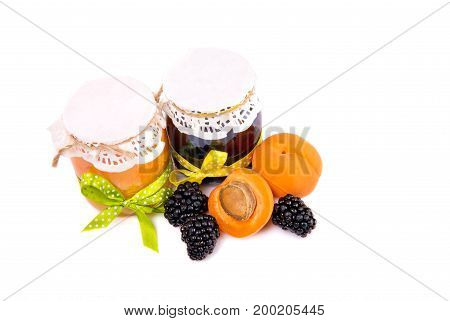 Two Glass Jar With Apricot Jam And Blackberry Jam With Half Apricot And Blackberry Berry On Isolated