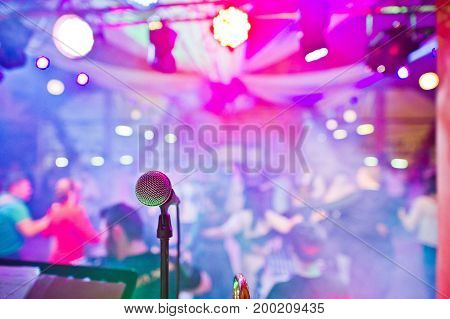 Close-up Photo Of A Microphone In The Night Club.