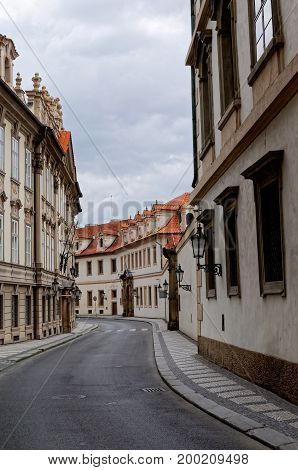 Street between old tenements houses with red tiles.