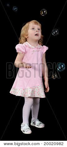 Little Girl And Soap Bubbles.