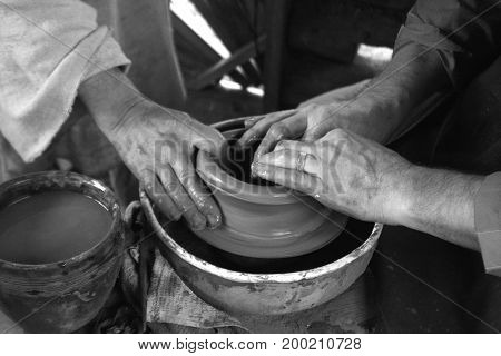 Potter And His Traynee Hands In Black And White