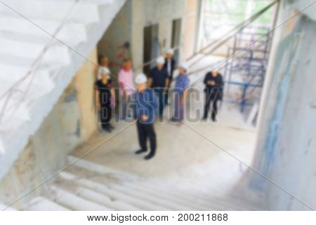blur of group businessman engineering check in construction building working site with copy space add text
