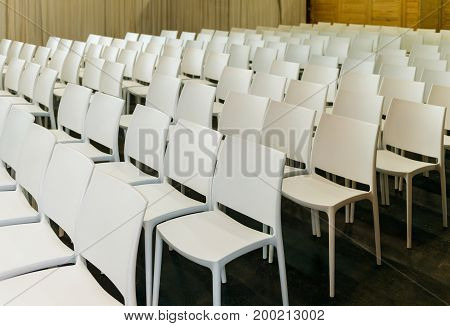 White chairs seats in conference room lecture audience or presentation hall