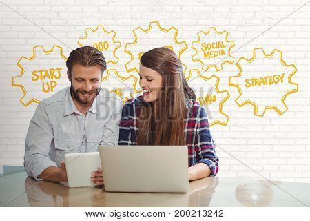 Digital composite of Happy business people at a desk looking at a tablet and a computer against white wall with yellow gr