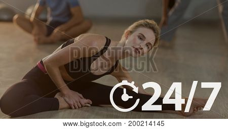 Digital composite of 24/7 icon against woman exercising photo