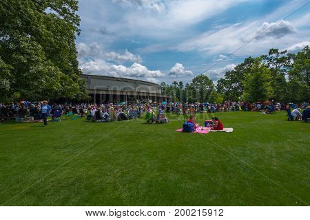 Tanglewood between Lenox and Stockbridge MA USA --8/17/2017 People relaxing and enjoying picnics in a park waiting for a concert to begin. Editorial Use Only