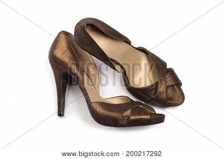 Pair of fashionable women shoes on white