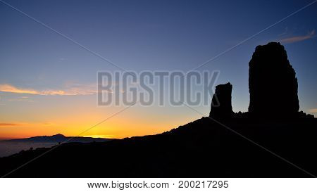 Vibrant sunset with intense blue sky, Roque Nublo and the frog, Canary islands