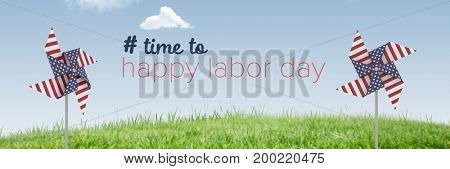 Digital composite of Happy labor day text and USA wind catchers in front of grass and sky