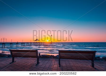 Brighton Beach view with people walking along jetty at sunset South Australia